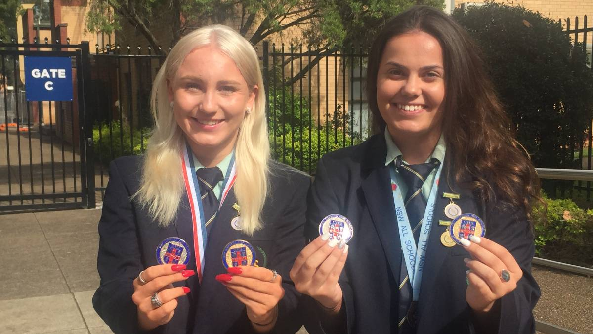 All smiles: Kristie Caplikas and Georgia Elphinston with some of their medals from 2020.