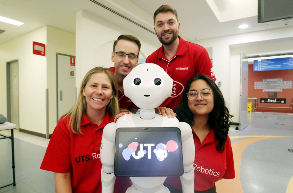 The Pepper humanoid robot with members of the UTS Magic Lab. Picture: Chris Lane