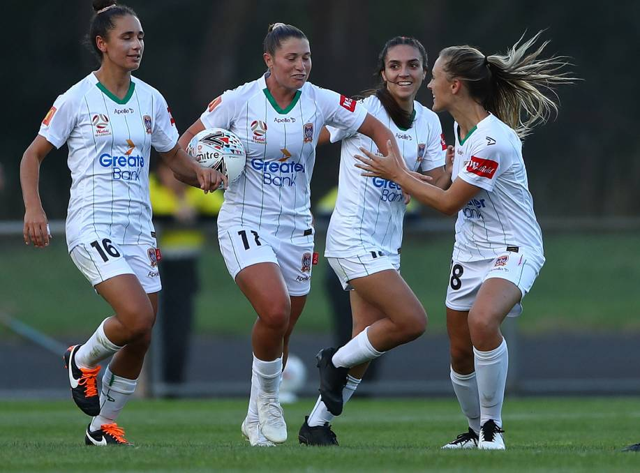 BREAKTHROUGH: Rhianna Pollicina is congratulated by Jets teammates after scoring at Latrobe City Stadium on Sunday. Picture: Getty Images