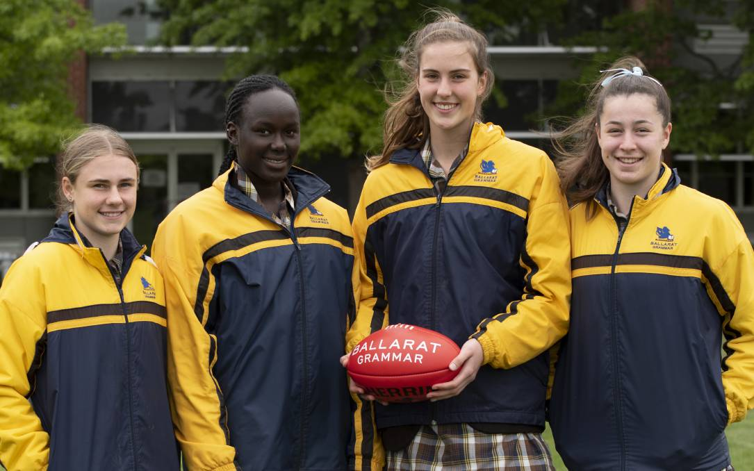 ALL IN: Ballarat Grammar School students and football teammates Renee Saulitis, left, Nyakoat Dojiok, Maggie Caris and Ella Friend.