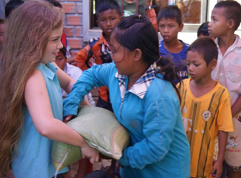 Helping hand: Taya has visited Cambodia twice. She and her family will visit Cambodia in January, where they hope to set up a classroom to teach computer skills,.